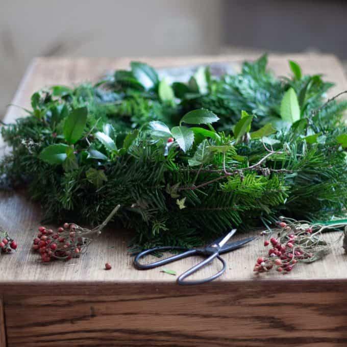 A fresh evergreen wreath on a table