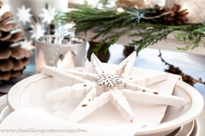 Clothespin snowflakes used as table settings on a Christmas tablescape
