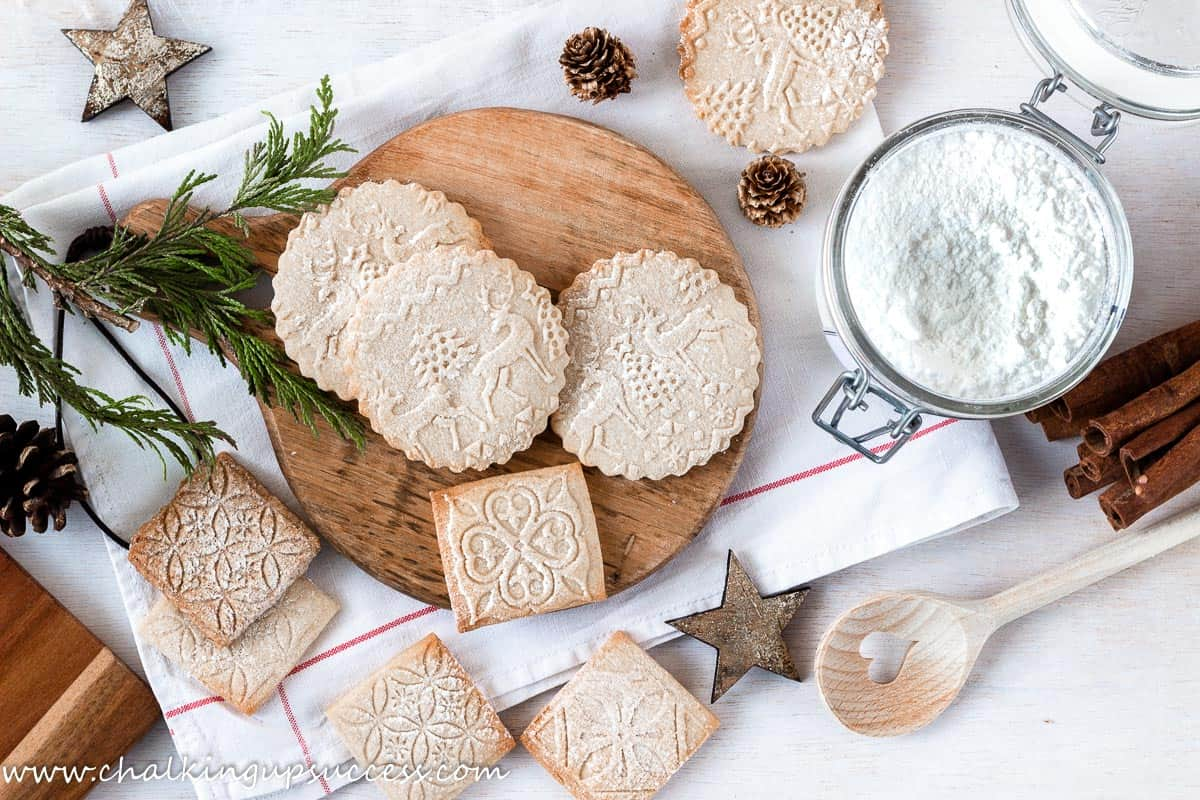 round Christmas cookies made with an embossed rolling pin