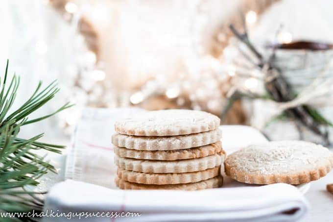 A stack of embossed cookies on a plate