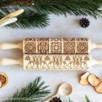 A Christmas flatlay scene with two embossed rolling pins - How to make Christmas cookies with an embossed rolling pin