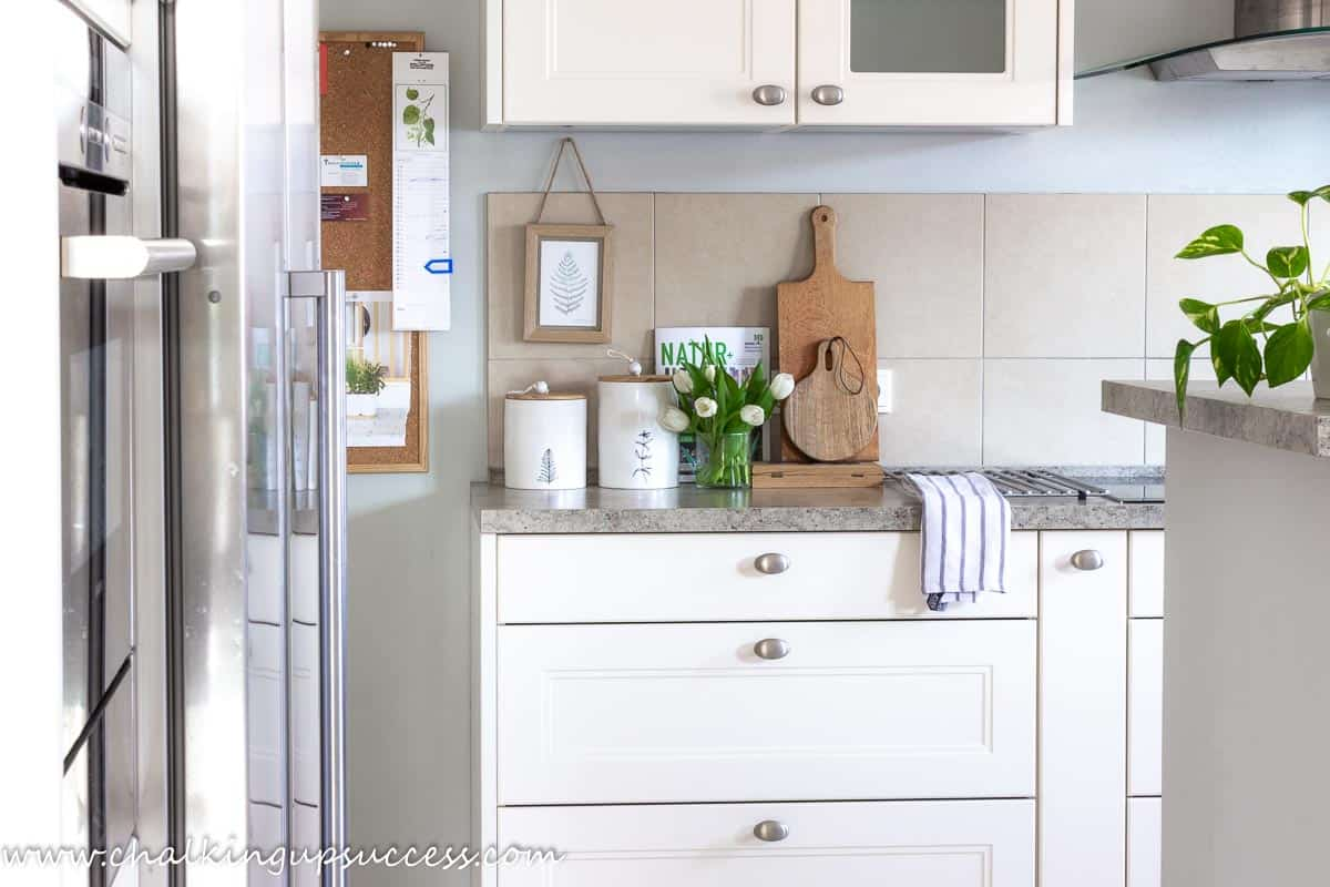 Kitchen spring home tour - vase of white tulips on the kitchen counter.