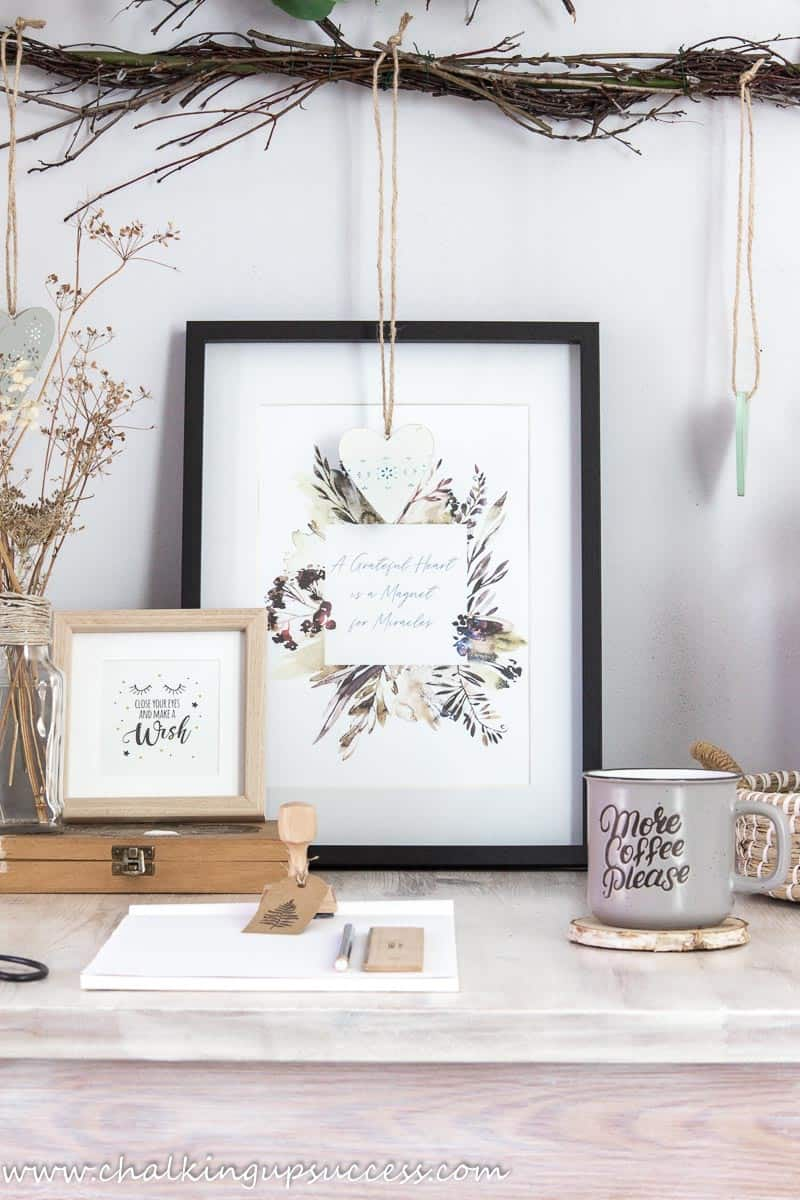 This ltall image can be saved to Pinterest - Front view of the whitewashed wood table styled with a block of paper, scissors and a cup of coffee.