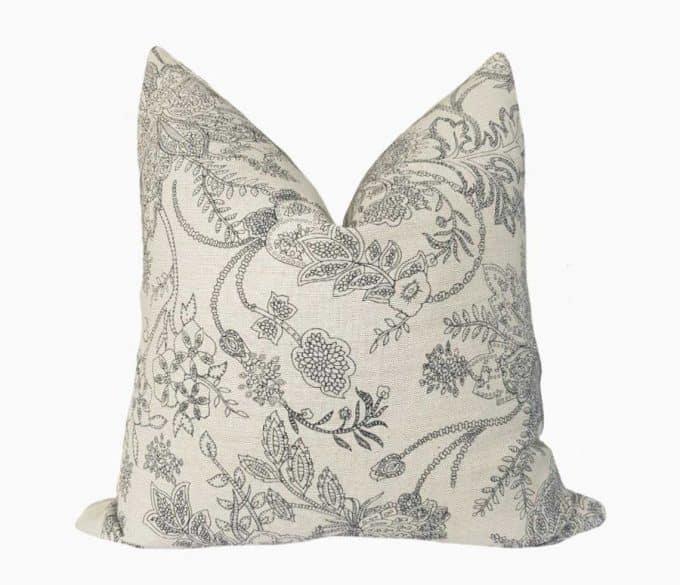 A pretty off-white pillow with a floral design - urban farmhouse decor