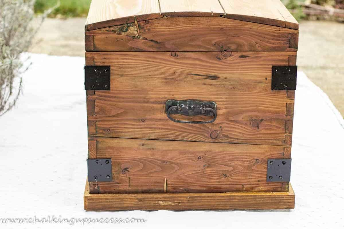 A side-view of the wooden trunk. Shows the original metal handle.