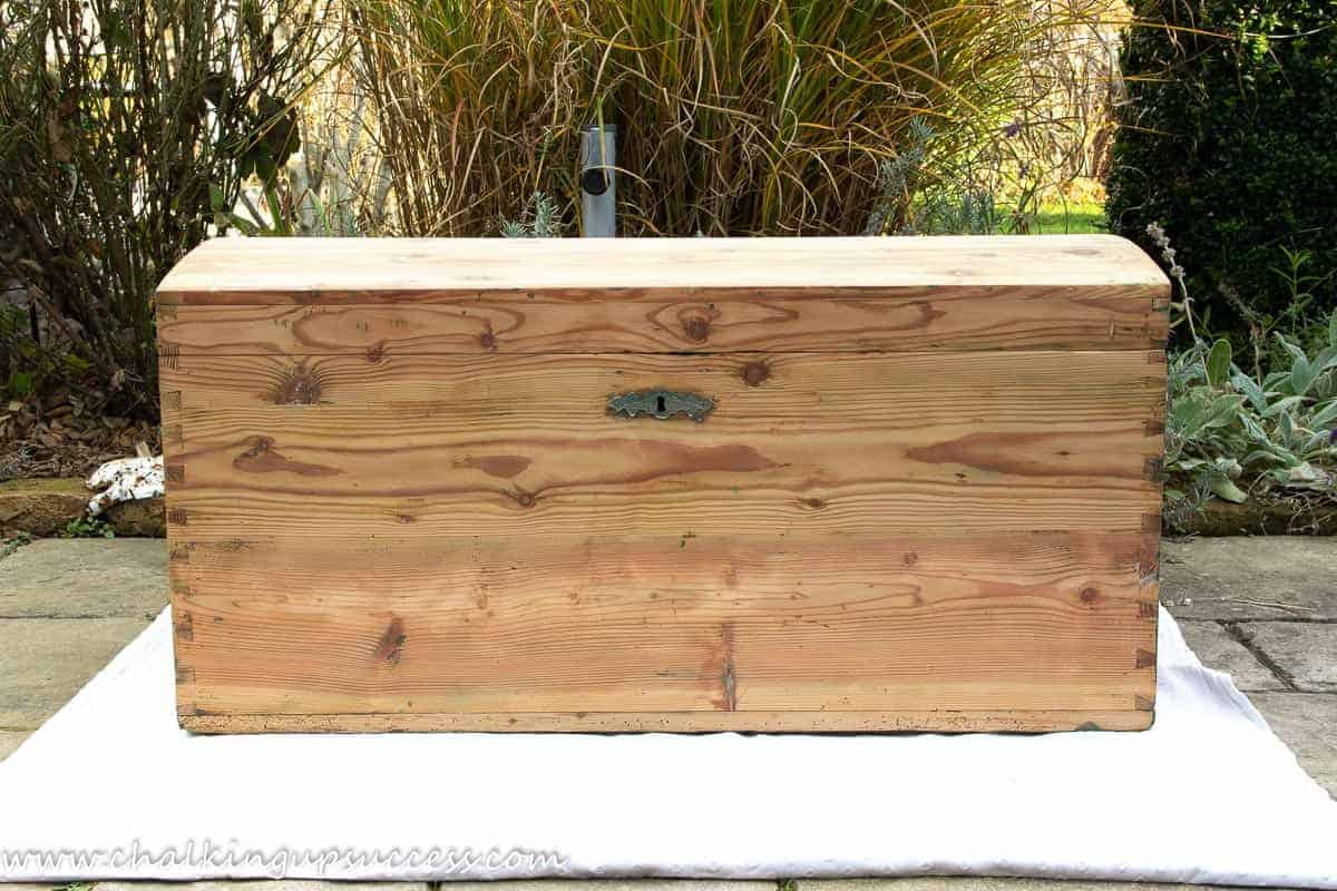 Photo of the wood trunk after sanding away the green woodstain.
