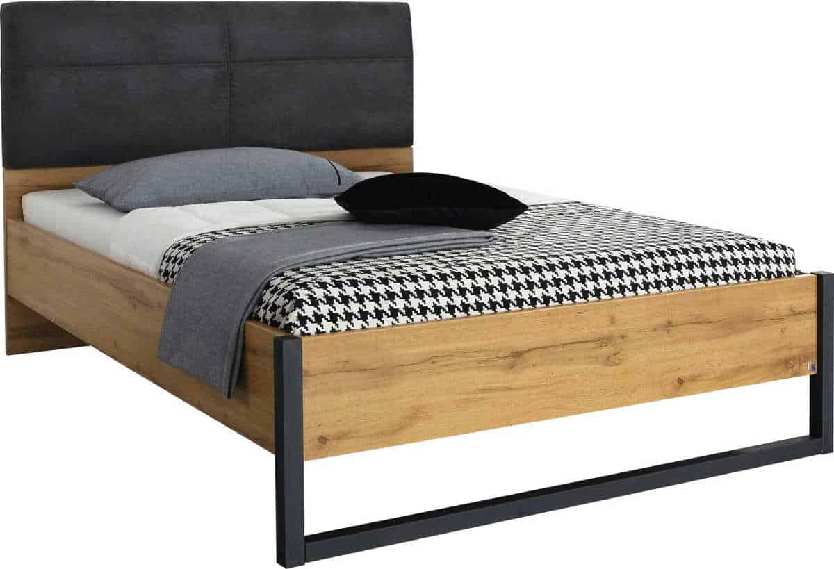 A bed for the industrial style bedroom - wood frame with black metal legs and a faux leather headboard in dark grey.