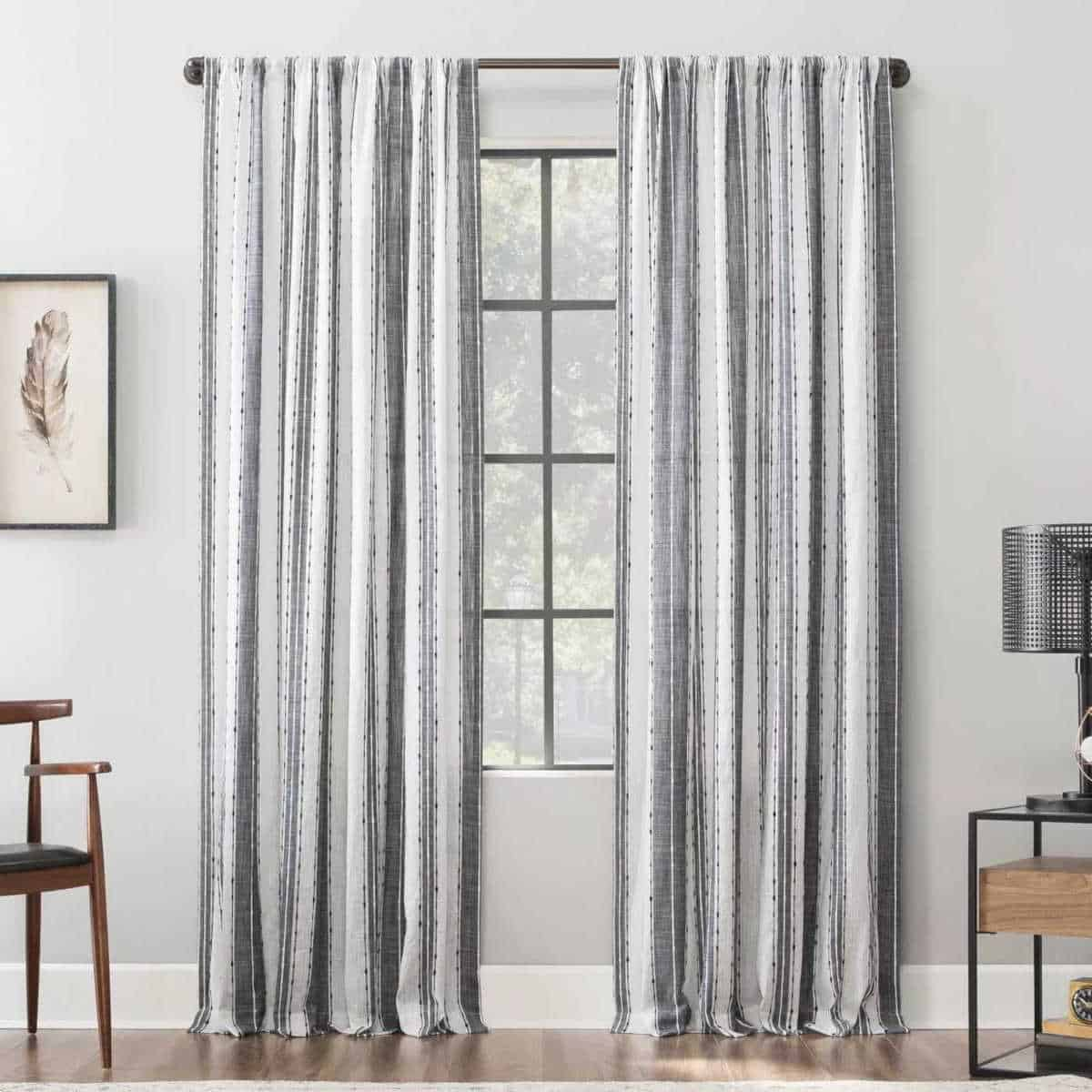 White curtains with a subtle back stripe.