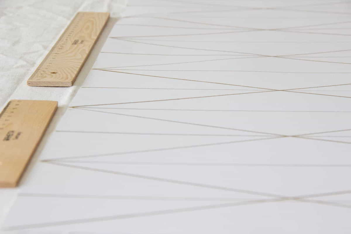 Lines drawn on a piece of strong white paper for making a DIY paper lamp - crafts and DIYs for adults and teens