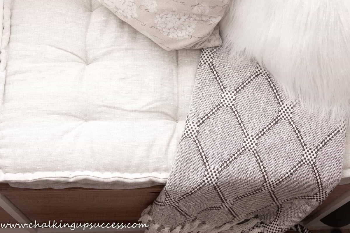 A french tufted mattress styled with a diagonal patterned throw and some pretty cream pillows - crafts and DIYs for adults and teens