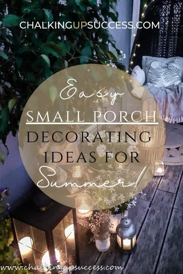 Small porch decor including a black swing chair, lanterns and candles.