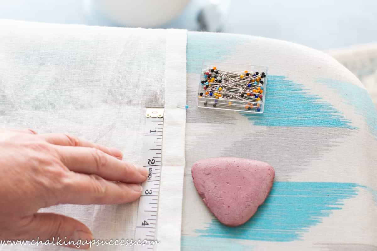 Measure from the pin to the end of the curtain - how to shorten curtains with a sewing machine