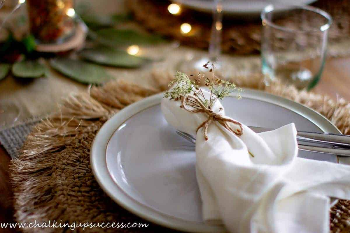 Decor ideas for the dining room - napkins tied with string and a sprig of Autumn flowers.