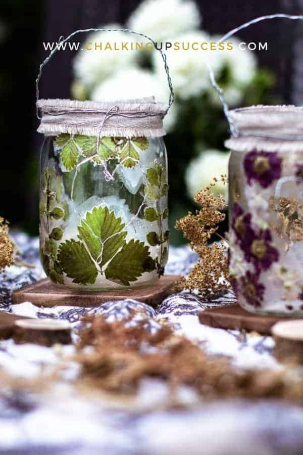 Glass jar lanterns made with dried strawberry leaves.