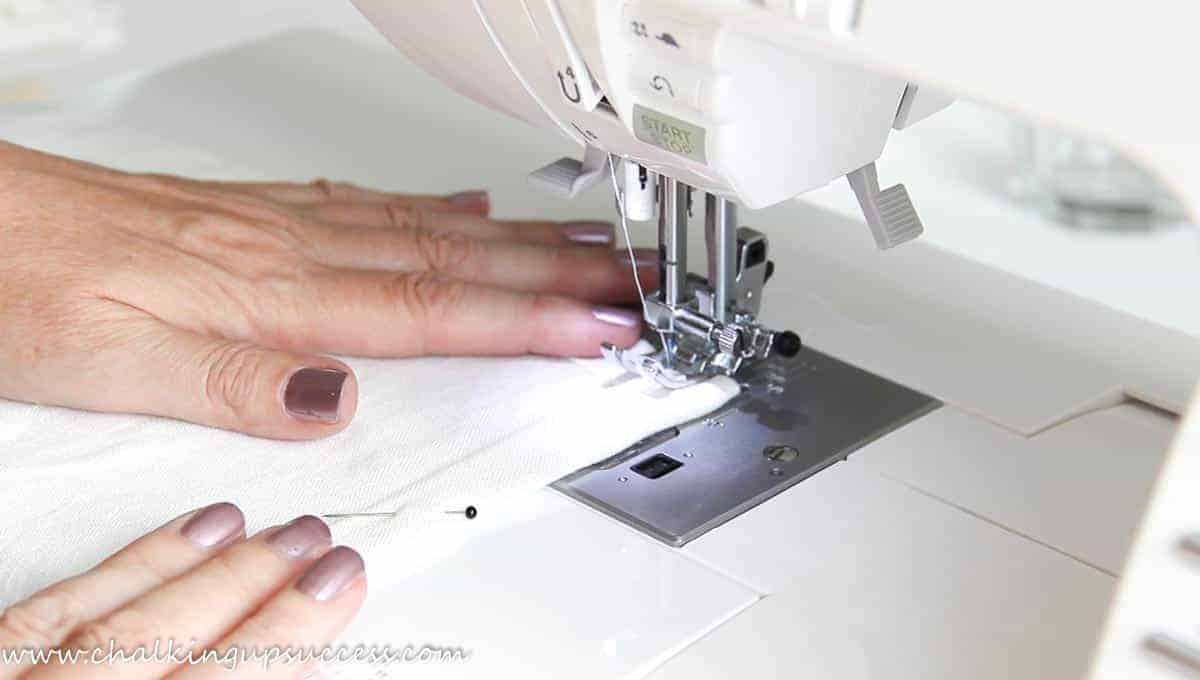 Sewing a square hem with a sewing machine to make a napkin