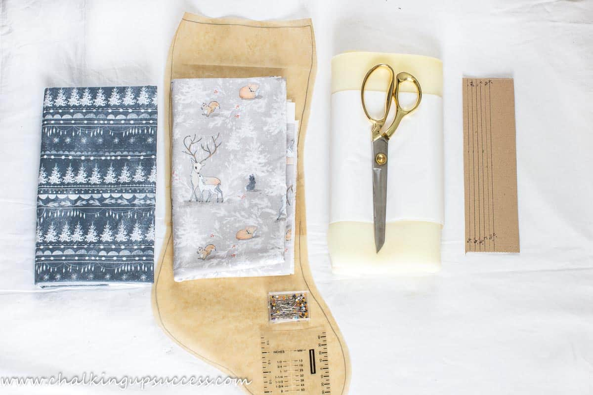 A Christmas stocking pattern and fabric ready to make a Christmas stocking
