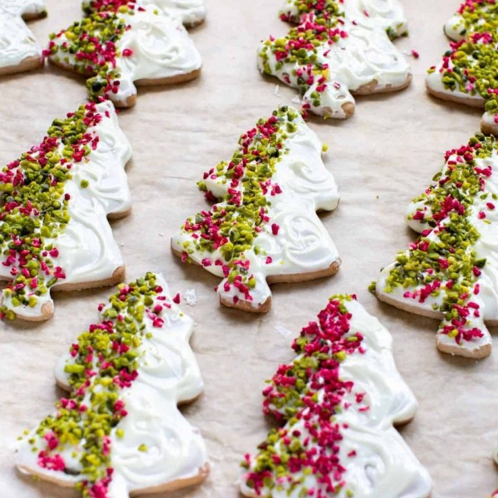A tray full of chocolate-dipped Christmas tree sugar cookies